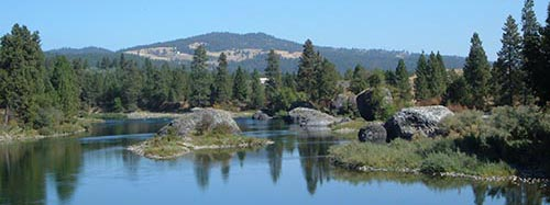 scenic view of the Spokane River with mountain
